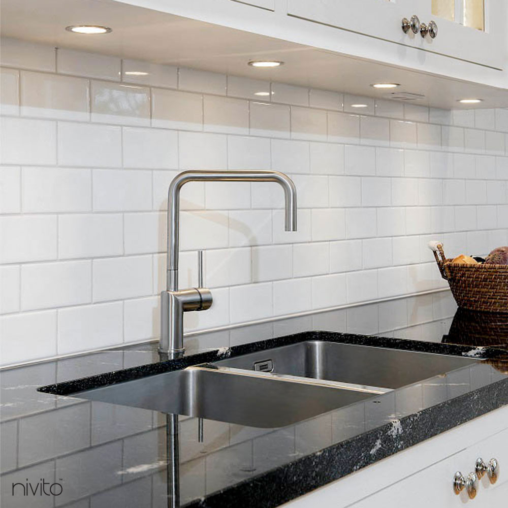 Brushed steel tap